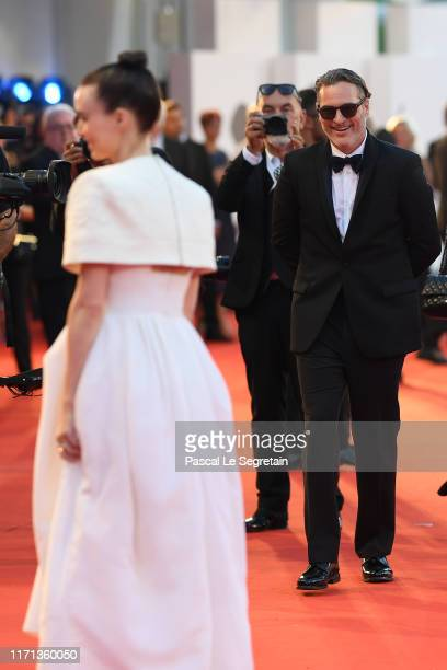 Rooney Mara and Joaquin Phoenix walk the red carpet ahead of the Joker screening during the 76th Venice Film Festival at Sala Grande on August 31...