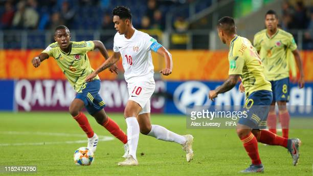 Roonui Tehau of Tahiti competes for the ball with Andres Perea of Colombia during the 2019 FIFA U-20 World Cup group A match between Colombia and...