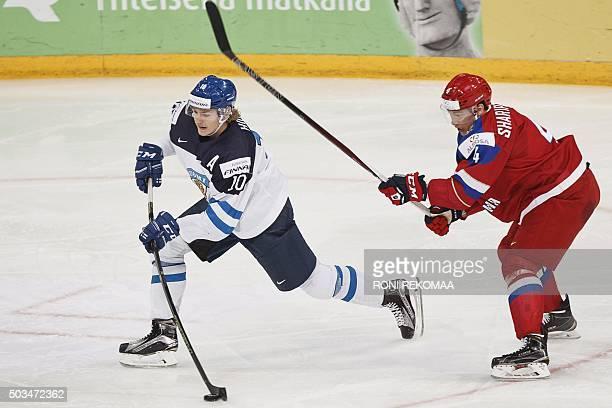 Roope Hintz of Finland and Damir Sharipzyanov of Russia vie during the 2016 IIHF World Junior Ice Hockey Championship final match Finland vs Russia...