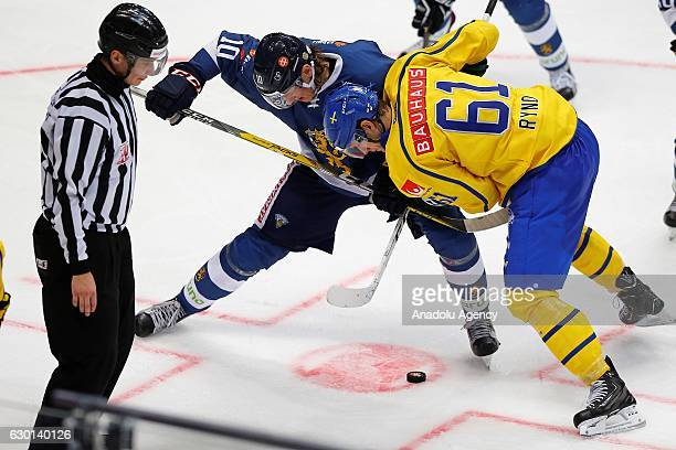 Roope Hintz of Finland in action against Johan Ryno of Sweden during the Euro Hockey tour Channel One Cup match between Finland and Sweden at the VTB...