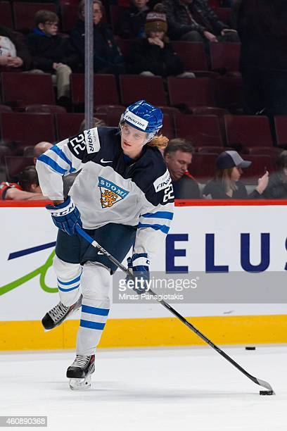 Roope Hintz of Team Finland looks to play the puck during the warmup period prior to the 2015 IIHF World Junior Hockey Championship game against Team...