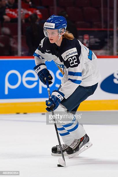 Roope Hintz of Team Finland skates with the puck during the warmup period prior to the 2015 IIHF World Junior Hockey Championship game against Team...
