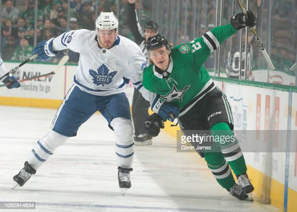 Roope Hintz of the Dallas Stars battles against Frederik Gauthier of the Toronto Maple Leafs at the American Airlines Center on October 9 2018 in...