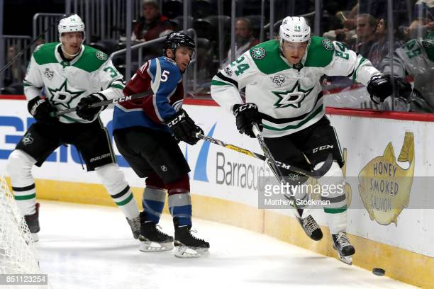 Roope Hintz of the Dallas Stars battles on the boards against David Warsofsky of the Colorado Avalanche at the Pepsi Center on September 21 2017 in...