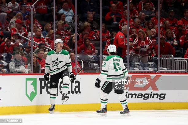 Roope Hintz of the Dallas Stars celebrates a second period goal with Mattias Janmark against the Washington Capitals at Capital One Arena on October...