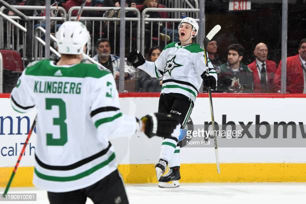 Roope Hintz of the Dallas Stars celebrates after scoring a goal against the Arizona Coyotes during the third period of the NHL hockey game at Gila...