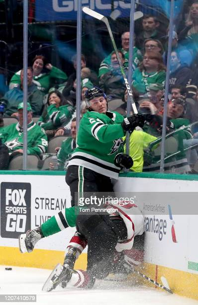 Roope Hintz of the Dallas Stars checks Nick Schmaltz of the Arizona Coyotes into the boards in the second period at American Airlines Center on...