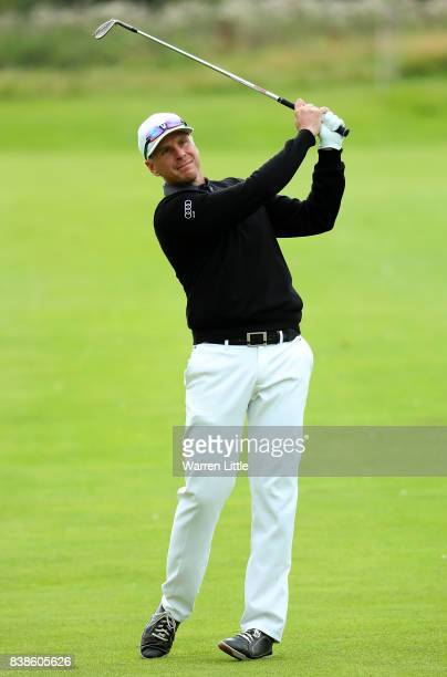 Roope Kakko of Finland hits his second shot on the 18th hole during day one of Made in Denmark at Himmerland Golf Spa Resort on August 24 2017 in...