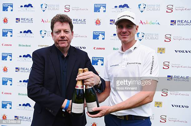 Roope Kakko of Finland is presented with champagne after his holeinone on the 12th hole during day two of the Open de Espana at Real Club Valderrama...