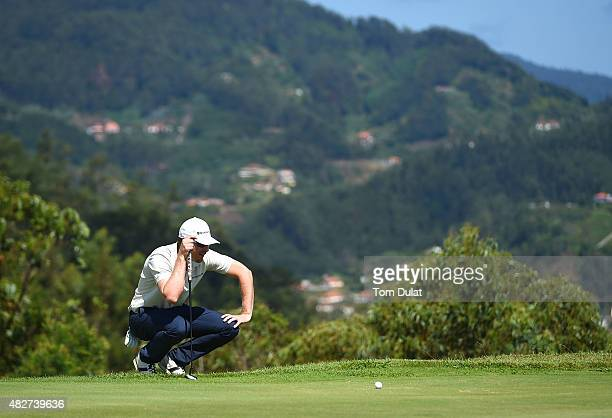 Roope Kakko of Finland lines up a putt on the 4th green during day four of the Madeira Islands Open Portugal BPI at Club de Golf do Santo da Serra on...