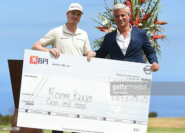 Roope Kakko of Finland poses with Diogo Louro after winning the Madeira Islands Open Portugal BPI at Club de Golf do Santo da Serra on August 2 2015...