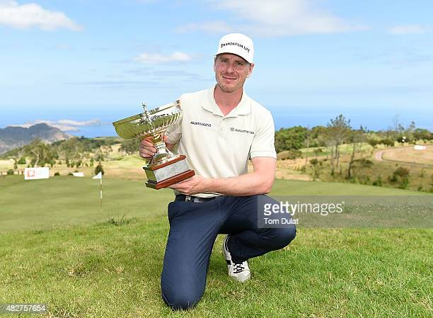 Roope Kakko of Finland poses with the trophy after winning the Madeira Islands Open Portugal BPI at Club de Golf do Santo da Serra on August 2 2015...