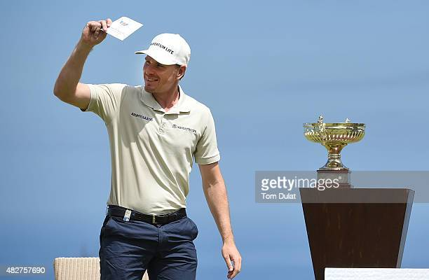 Roope Kakko of Finland smiles prior to receiving the trophy after winning the Madeira Islands Open Portugal BPI at Club de Golf do Santo da Serra on...