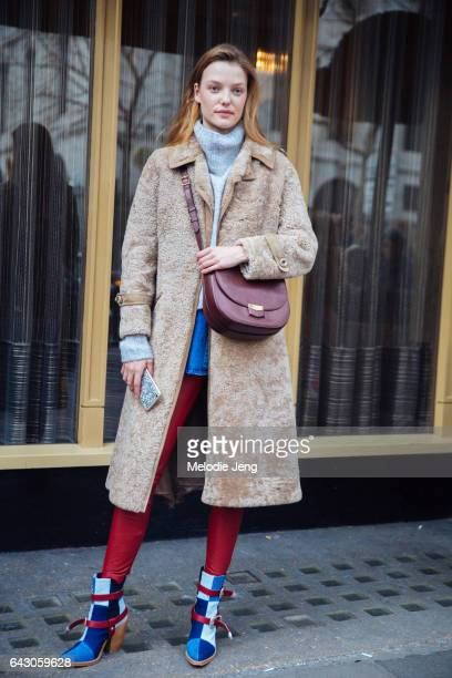 Roos Abels carries a Celine bag on day 3 of the London Fashion Week February 2017 collections on February 19 2017 in London England