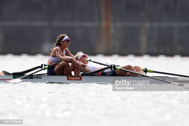 Roos de Jong and Lisa Scheenaard of Team Netherlands react after winning the bronze medal during the Women's Double Sculls Final A on day five of the...