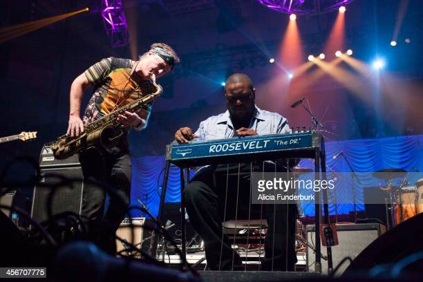 Roosevelt Collier performs with Bill Evans at the 25th Annual Warren Haynes Christmas Jam at US Cellular Center on December 14, 2013 in Asheville,...