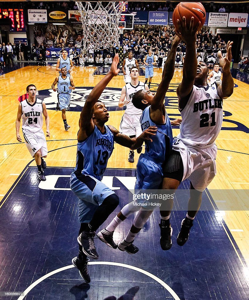 Roosevelt Jones #21 of the Butler Bulldogs goes up for a shot as T.J. Buchanan #13 of the Rhode Island Rams and Xavier Munford #5 of the Rhode Island Rams defend at Hinkle Fieldhouse on February 2, 2013 in Indianapolis, Indiana. Butler defeated Rhode Island 75-68.