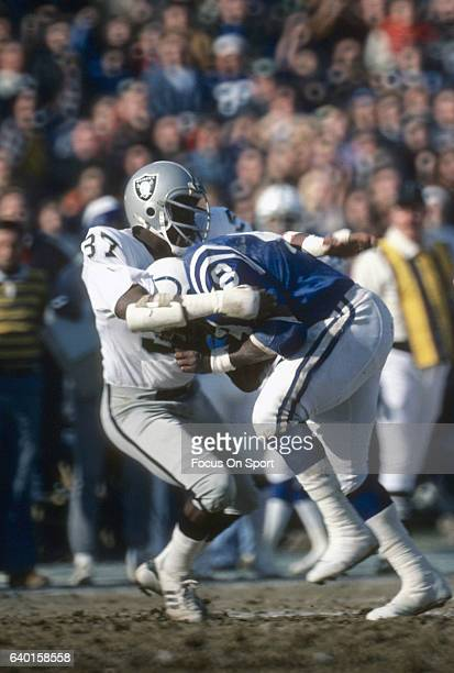 Roosevelt Leaks of the Baltimore Colts gets tackled by Lester Hayes of the Oakland Raiders during The AFC Divisional Playoff Game December 24 1977 at...