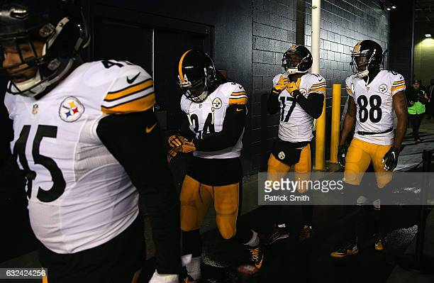 Roosevelt Nix DeAngelo Williams Eli Rogers and Darrius HeywardBey of the Pittsburgh Steelers walk to the field prior to the AFC Championship Game...