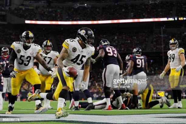 Roosevelt Nix of the Pittsburgh Steelers rushes for a touchdown in the second quarter against the Houston Texans at NRG Stadium on December 25 2017...