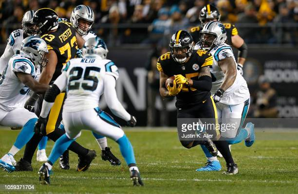 Roosevelt NixJones of the Pittsburgh Steelers carries the ball against Eric Reid of the Carolina Panthers during the first half in the game at Heinz...