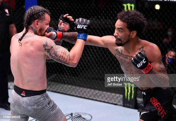 Roosevelt Roberts punches Brok Weaver in their lightweight fight during the UFC Fight Night event at UFC APEX on May 30 2020 in Las Vegas Nevada