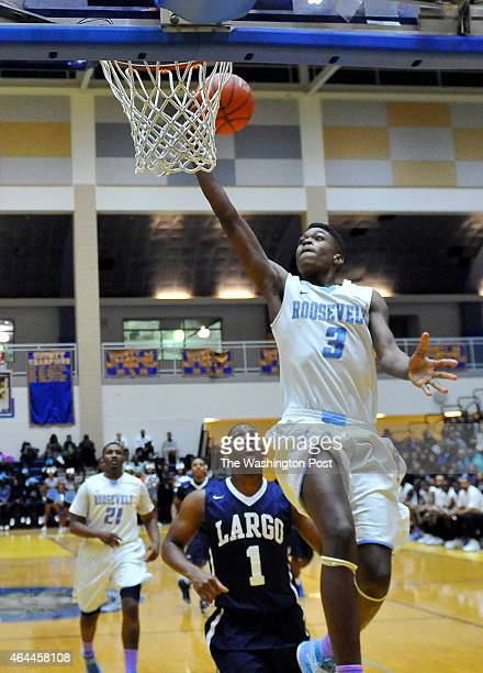Roosevelt's Naji Marshall sails to the basket in front of Largo's Isaiah Boggs in the Prince Georges County championship game at Dr Henry Wise High...