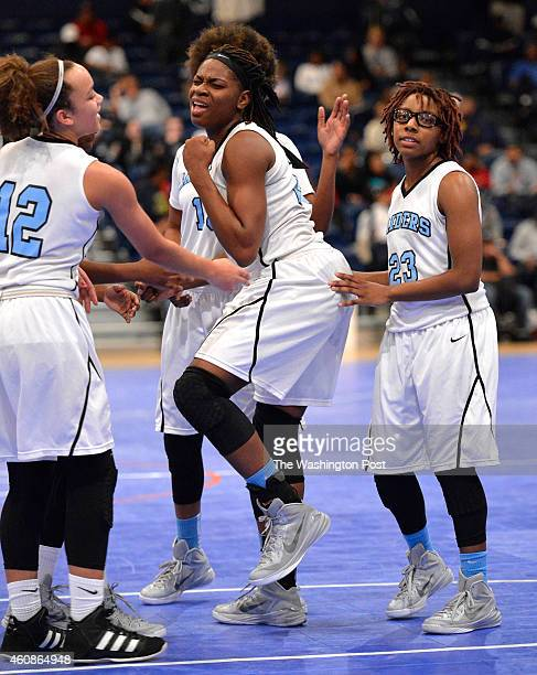 Roosevelt's Tolulope Omokore celebrated getting fouled late in the overtime victory over Good Counsel in the Title IX Classic at the DC Armory on...