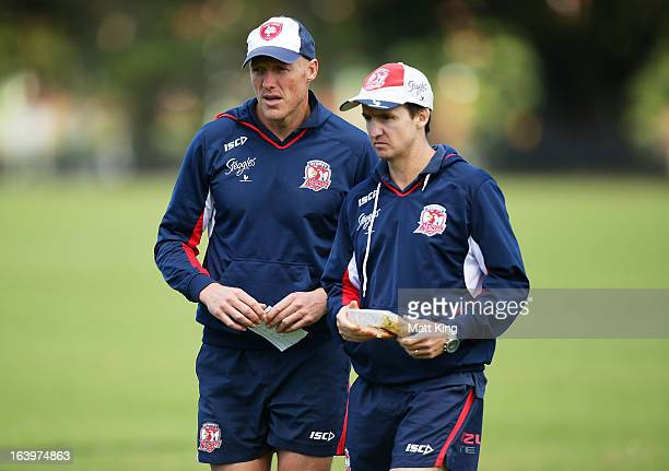 Roosters assistant coaches Craig Fitzgibbon and Jason Taylor look on during a Sydney Roosters NRL training session at Moore Park on March 19 2013 in...