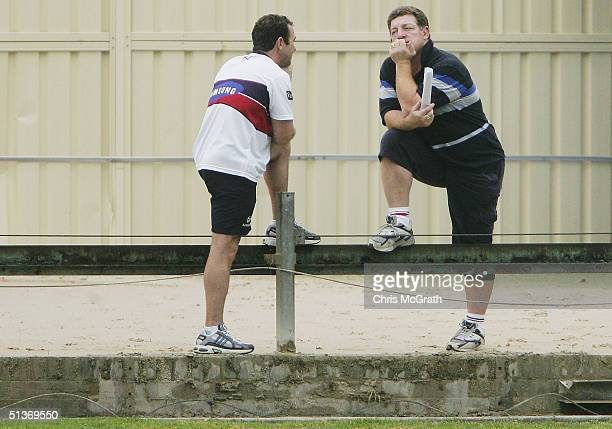 Roosters coach Ricky Stuart and Phil Gould chat during the Sydney Roosters training session held at Wentworth Park on September 29 2004 in Sydney...