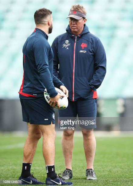 Roosters coach Trent Robinson talks to James Tedesco during a Sydney Roosters NRL training session at Allianz Stadium on September 24, 2018 in...
