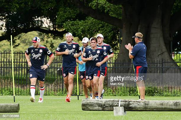 Roosters coach Trent Robinson watches his players during a Sydney Roosters training session on January 28 2016 in Sydney Australia