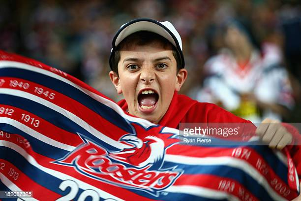Roosters fan cheers during the NRL Preliminary Final match between the Sydney Roosters and the Newcastle Knights at Allianz Stadium on September 28...