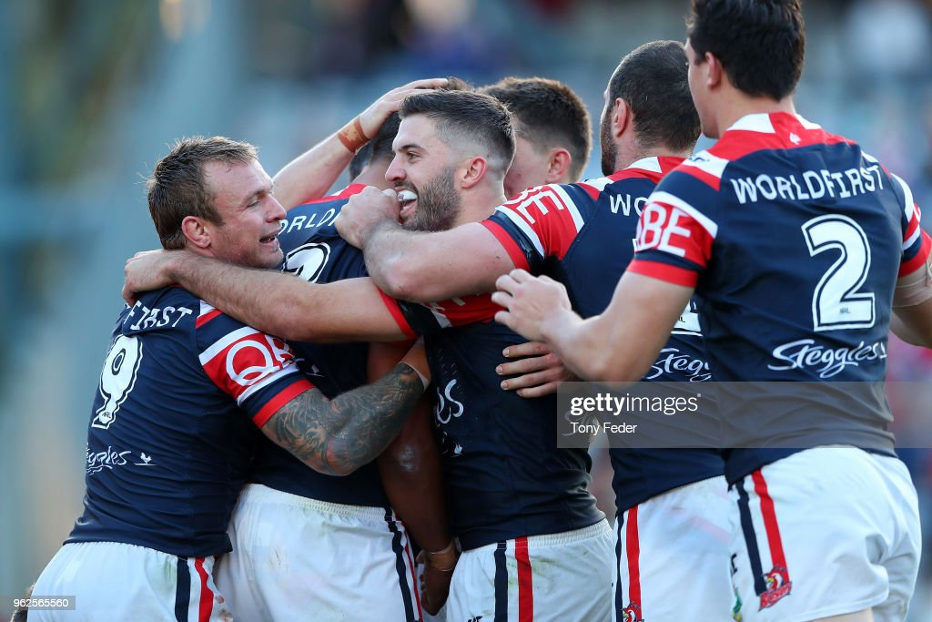 Roosters players celebrate a try during the round 12 NRL match between the Sydney Roosters and the Gold Coast Titans at Central Coast Stadium on May 26, 2018 in Gosford, Australia.