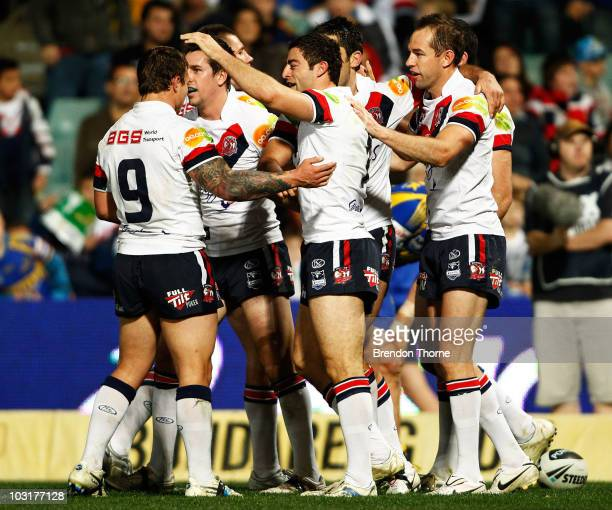 Roosters players celebrate after scoring against the Eels during the round 21 NRL match between the Parramatta Eels and the Sydney Roosters at...