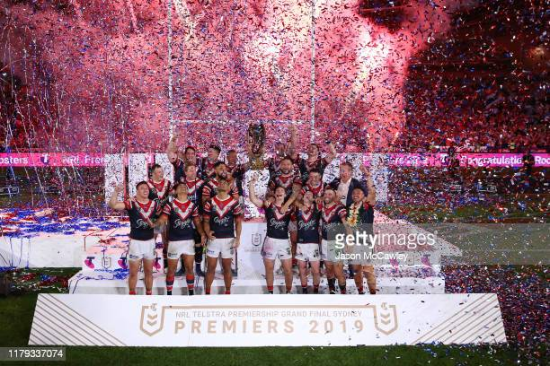 Roosters players celebrate victory during the 2019 NRL Grand Final match between the Canberra Raiders and the Sydney Roosters at ANZ Stadium on...