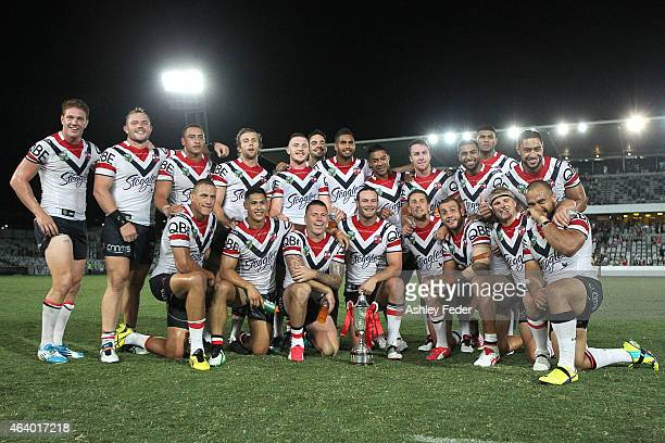 Roosters players celebrate winning during the NRL Trial Match between the Sydney Roosters and the Manly Sea Eagles at Central Coast Stadium on...