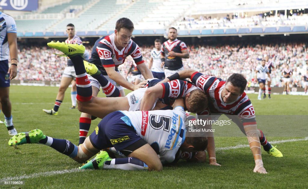 Roosters players fail to score a try during the round 26 NRL match between the Sydney Roosters and the Gold Coast Titans at Allianz Stadium on September 2, 2017 in Sydney, Australia.