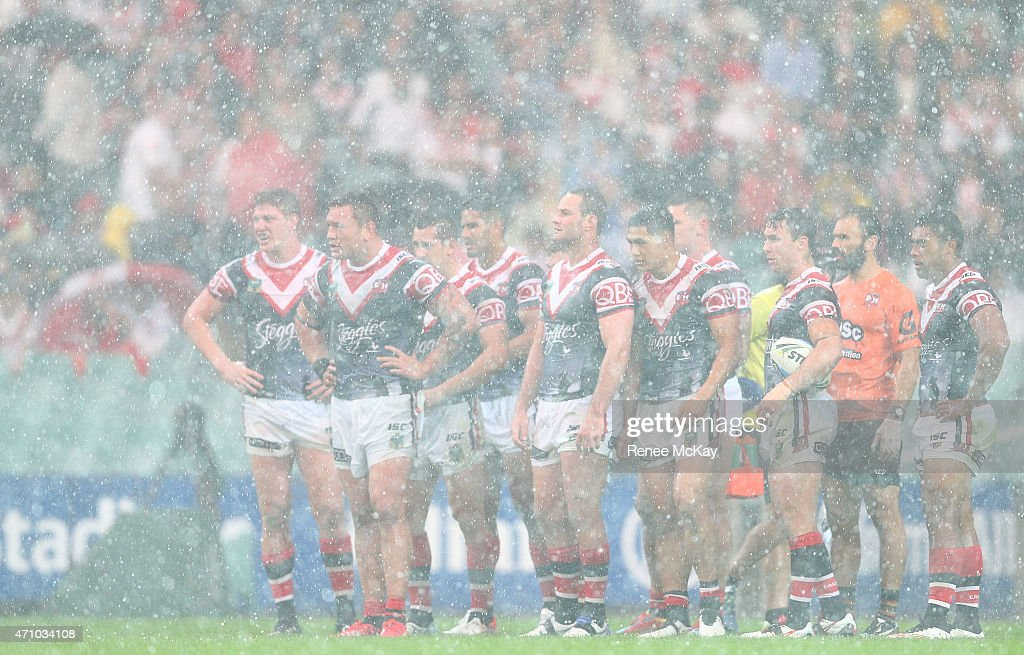 Roosters players in the hail and rain during the round eight NRL match between the Sydney Roosters and the St George Illawarra Dragons at Allianz Stadium on April 25, 2015 in Sydney, Australia.
