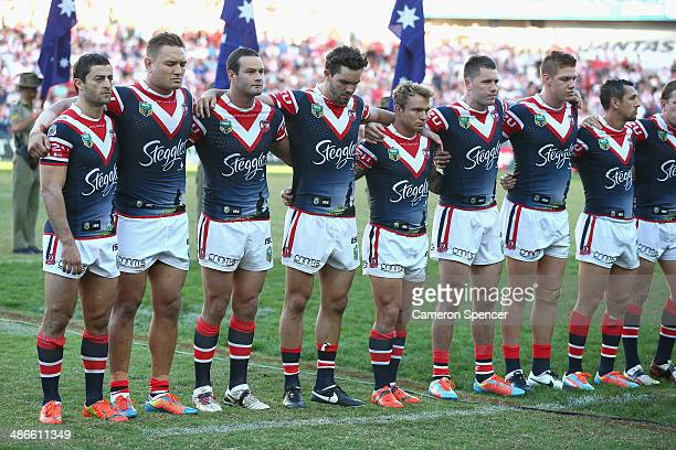 Roosters players line up during a minutes silence during the round 8 NRL match between the St George Illawarra Dragons and the Sydney Roosters at...