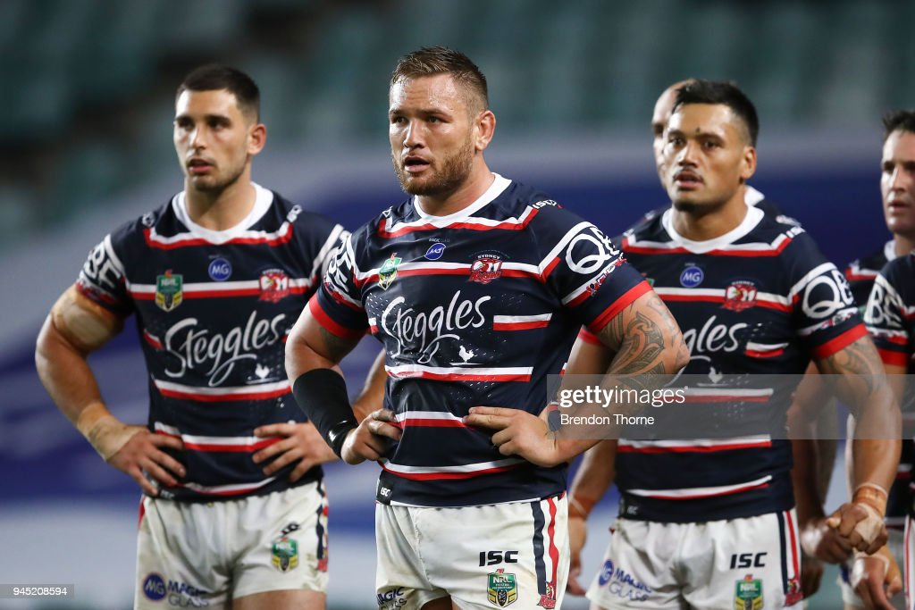 Roosters players show their dejection during the round six NRL match between the Sydney Roosters and the South Sydney Rabbitohs at Allianz Stadium on April 12, 2018 in Sydney, Australia.