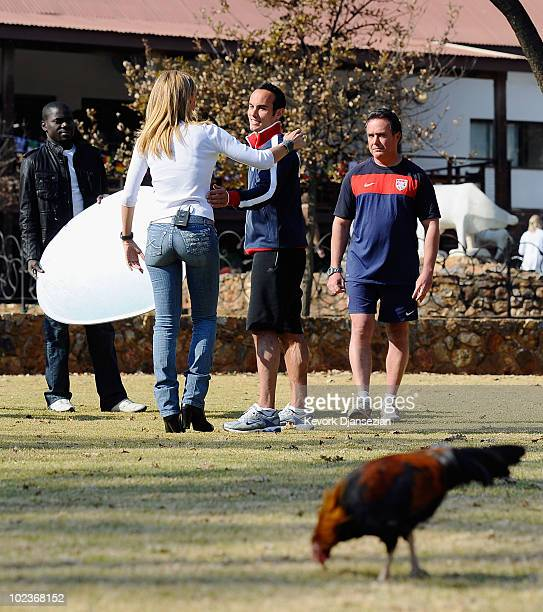 Roosters walk the grounds of Irene Farm as Landon Donovan of USA finishes an interview with TV Azteca of Mexico on June 24 2010 in Irene south of...