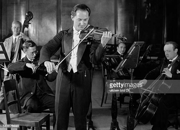 Roosz Emil Musician Conductor Germany*310718971945 playing violin Photographer Curt Ullmann Published by 'Sieben Tage' 36/1937Vintage property of...