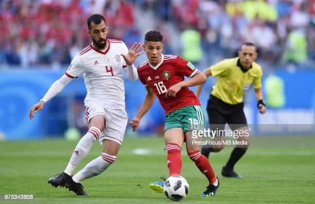 Roozbeh Cheshmi of Iran competes with Amine Harit of Morocco during the 2018 FIFA World Cup Russia group B match between Morocco and Iran at Saint...