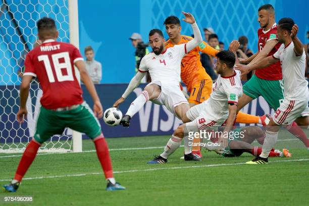 Roozbeh Cheshmi of Iran shoots on goal during the 2018 FIFA World Cup Russia group B match between Morocco and Iran at Saint Petersburg Stadium on...