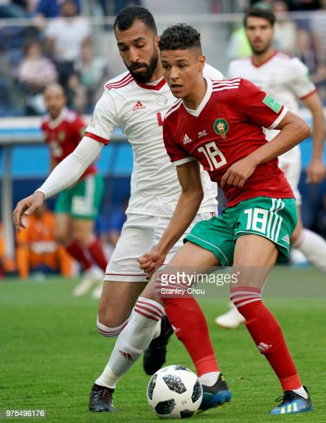 Roozbeh Cheshmiof Iran battles with Amine Harit of Morocco during the 2018 FIFA World Cup Russia group B match between Morocco and Iran at Saint...