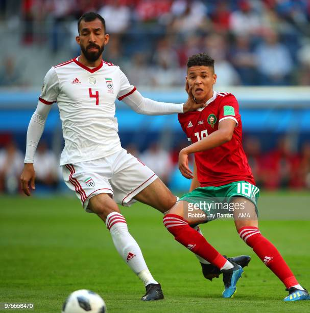 Roozebeh Cheshmi of IR Iran holds off Amine Harit of Morocco during the 2018 FIFA World Cup Russia group B match between Morocco and Iran at Saint...