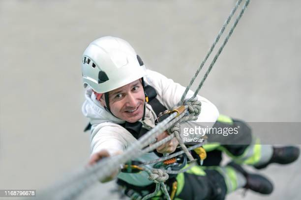 rope access irata worker - safety harness stock pictures, royalty-free photos & images