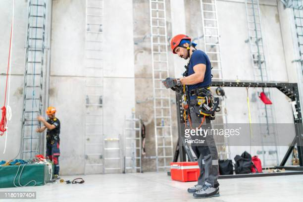 rope access technician doing preparation - safety harness stock pictures, royalty-free photos & images