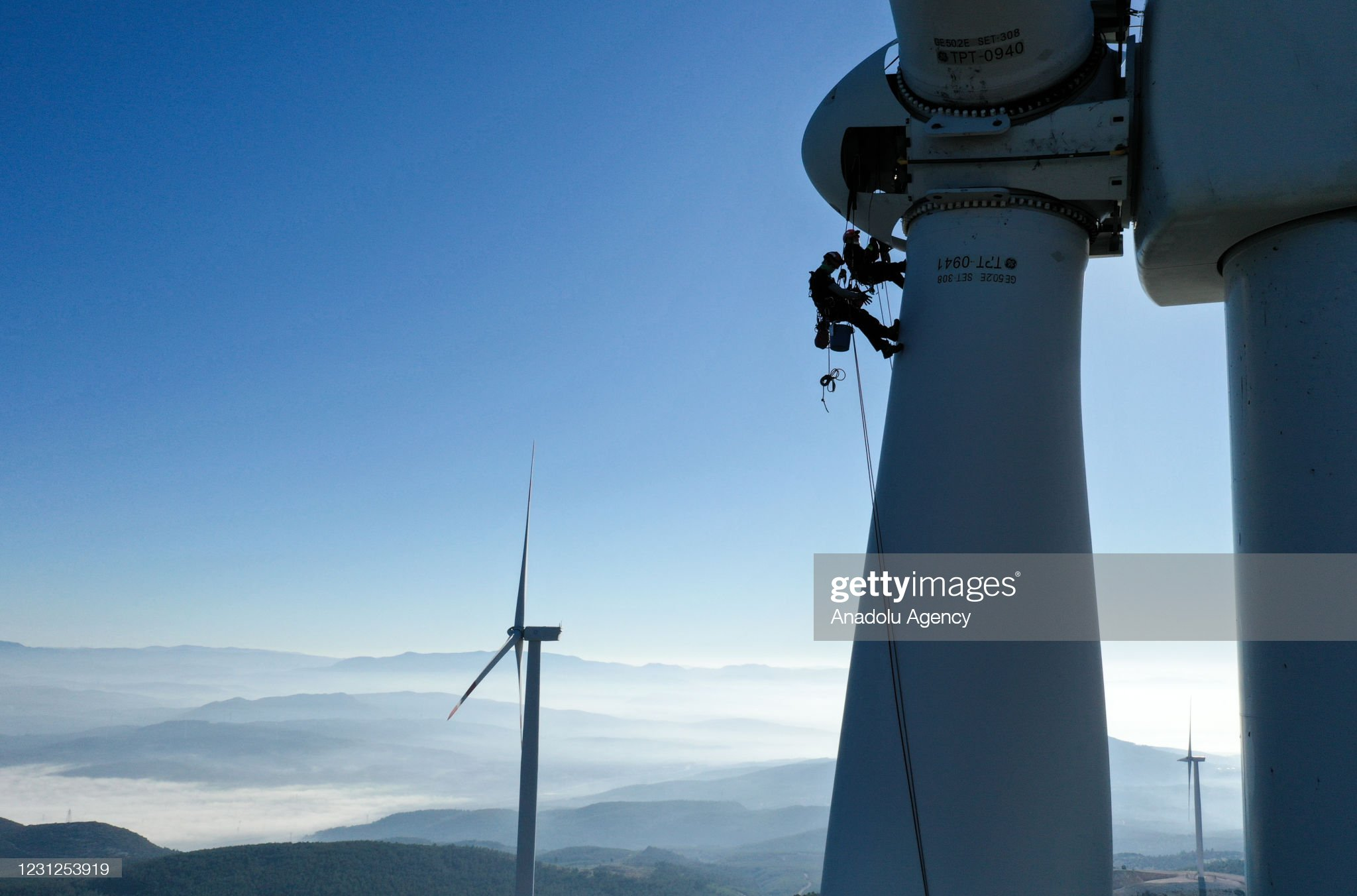 Rope access technicians work on wind turbines